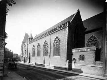 View of St George's Chapel from across the road. The gothic-style chapel was built in 1850 to serve the poorer population of St Mary Magdalen. By 1880 the congregation had dwindled and the church closed around 1918. A cinema was later built on the shortly