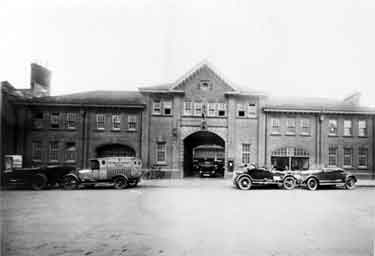 Vehicles outside the front of the Morris Garage