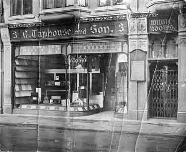 Looking across the west side of Magdalen Street (West) at Taphouses and Son, Music Shop