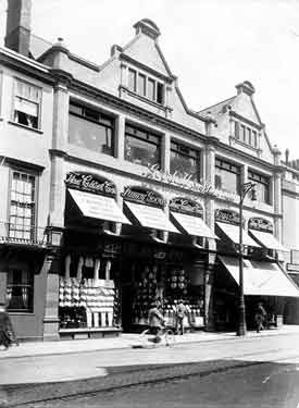 Cornmarket Street, Oxford, Oxfordshire. An exterior view of shop fronts on the east side of Cornmarket, showing the Goodall and Sheratt and Arthur Shepherd stores. The street remains a busy commerical place to this day.